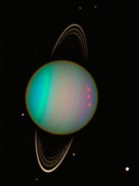 Piccole macchie aurorali fotografate dall'HST nel 2011 in corrispondenza del polo nord magnetico di Urano.